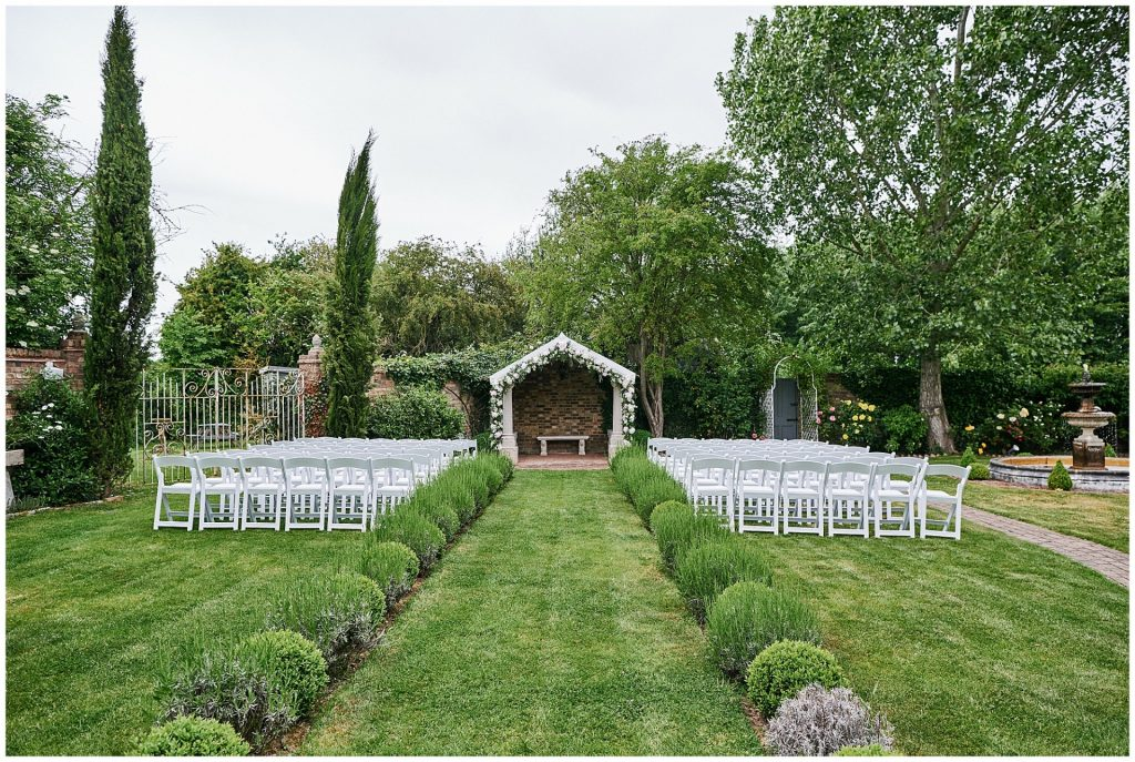 Outdoor walled garden wedding ceremony set up at Marleybrook House