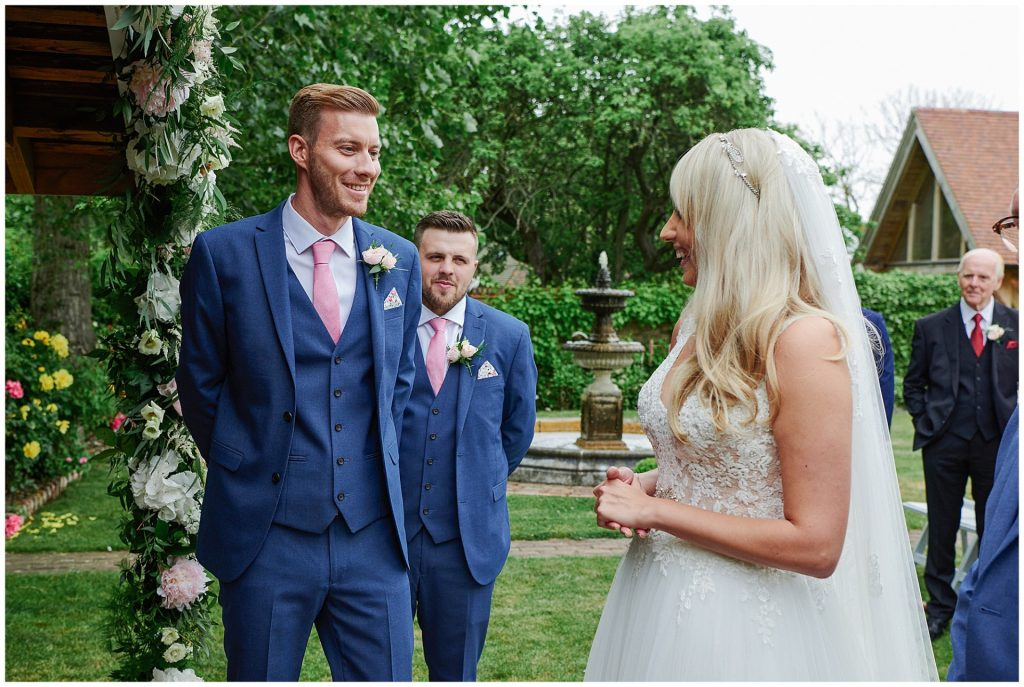 Bride and groom meeting during outdoor wedding ceremony at Marleybrook House