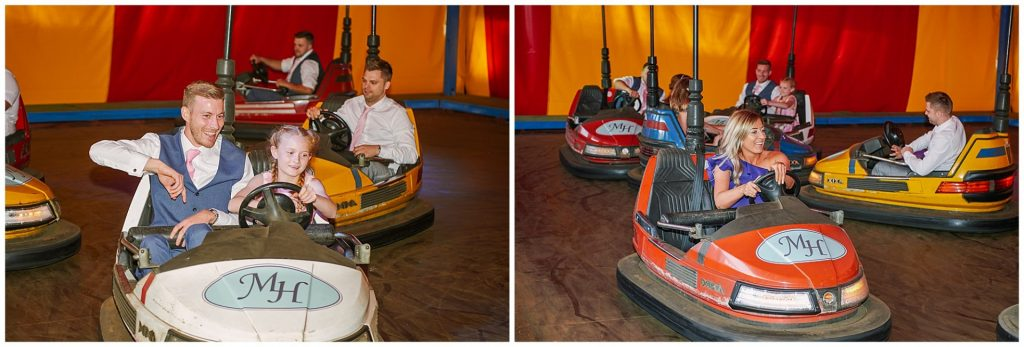 Wedding guests enjoying the dodgems at unique funfair wedding venue