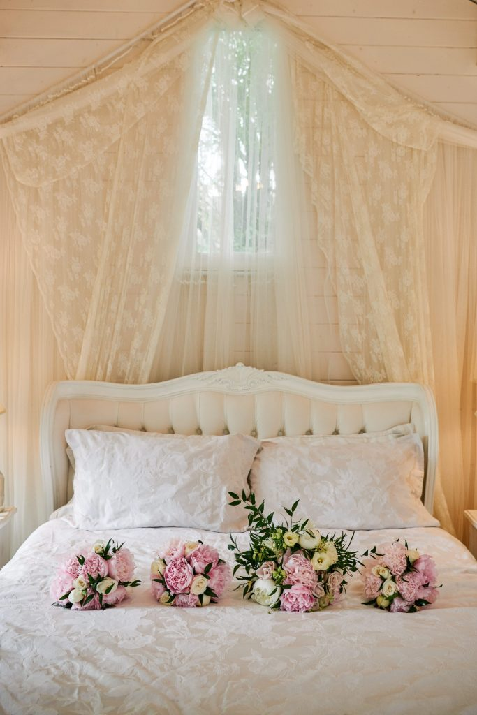 Flower wedding bouquets on a white bed at Marleybrook House