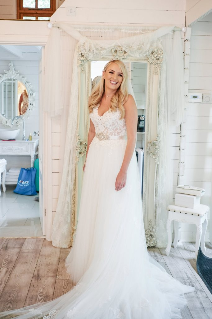 bride smiling in beautiful white dress during bridal prep at Marleybrook House
