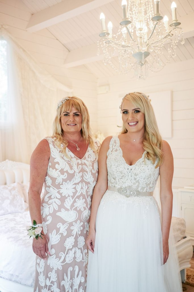 bride stood smiling with her mum in bridal prep room at Marleybrook House