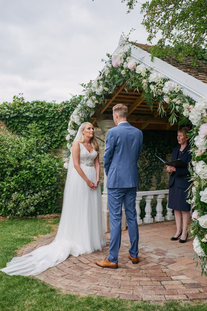 Happy Bride and groom during outdoor wedding ceremony at Marleybrook House