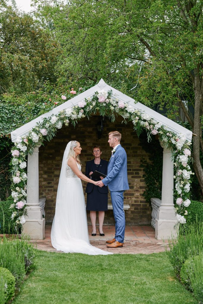Bride and groom during outdoor summer wedding ceremony at Marleybrook House
