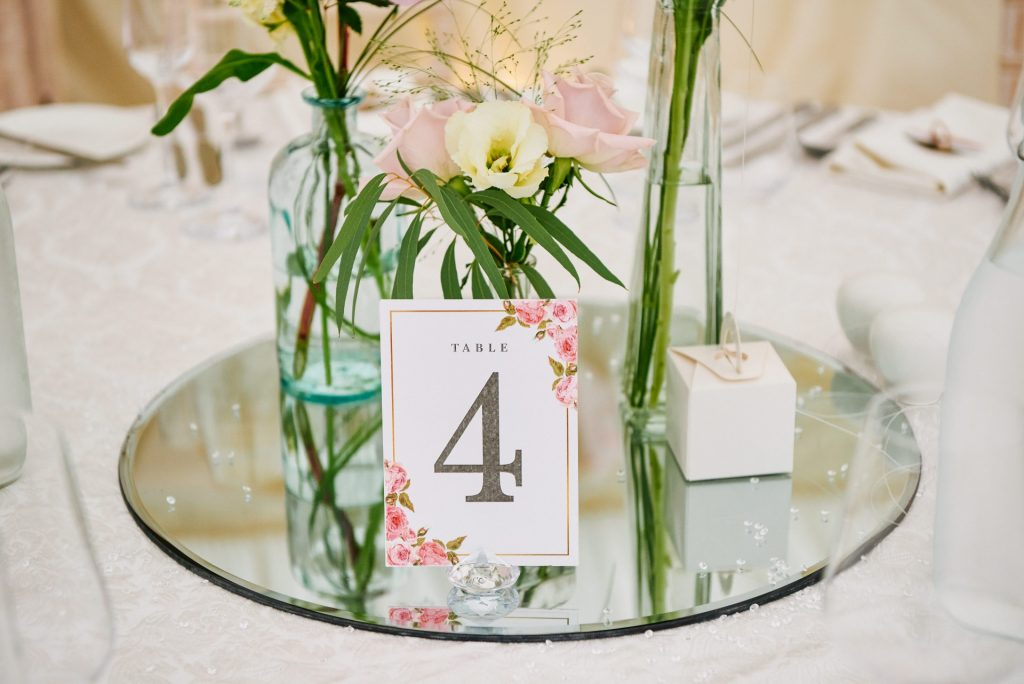 Wedding breakfast table details  showing flowers and number 4