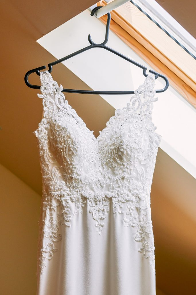 Beautiful wedding dress hung up at Micklefield Hall