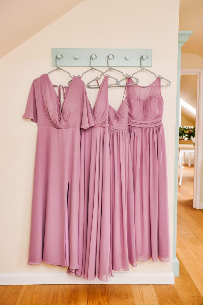 Lilac coloured bridesmaids dresses hung up in a row