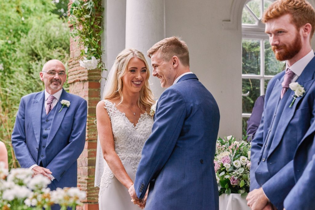 Happy bride and groom during beautiful outdoor wedding ceremony
