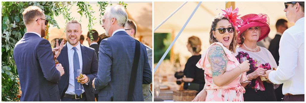 wedding guests socialising in a beautiful marquee tent at Pamber Place