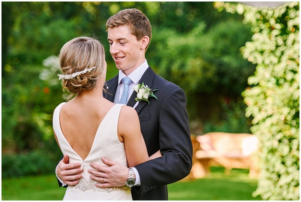 Bride and Groom having an intimate moment during their beautiful Pamber Place wedding