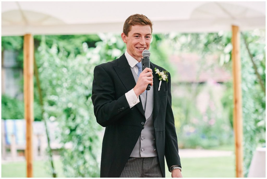 Groom giving a speech during his Pamber Place Wedding in a marquee