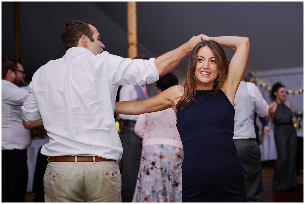 Wedding guests dancing during evening marquee reception at Pamber Place