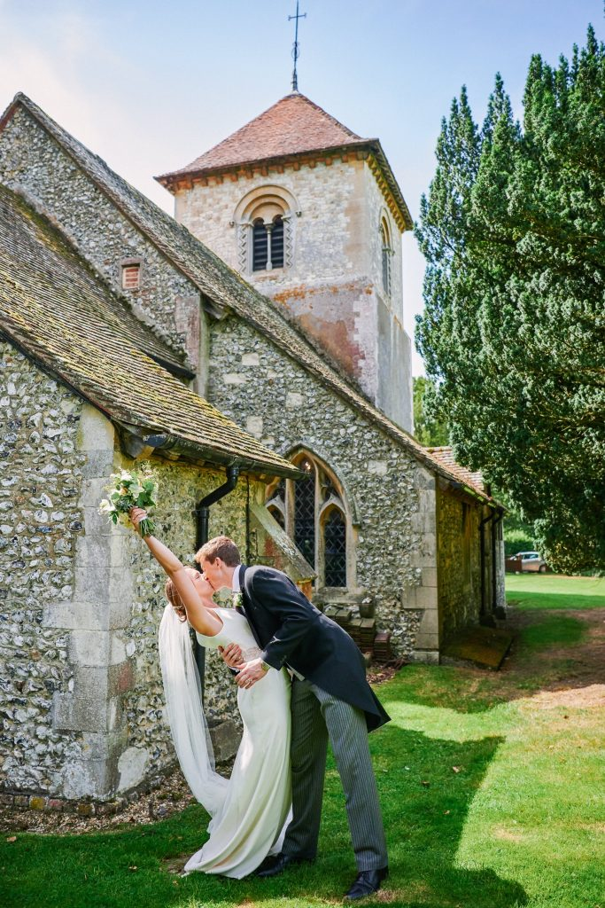 bride and groom celebrating outside of a church after their wedding ceremony