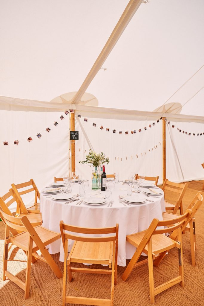 Wedding dinner table set up in marquee tent at  Pamber Place
