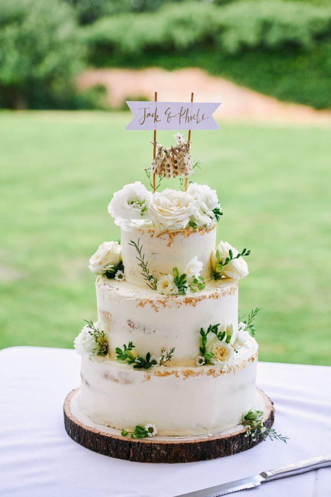 beautiful wedding cake at a summer festival wedding