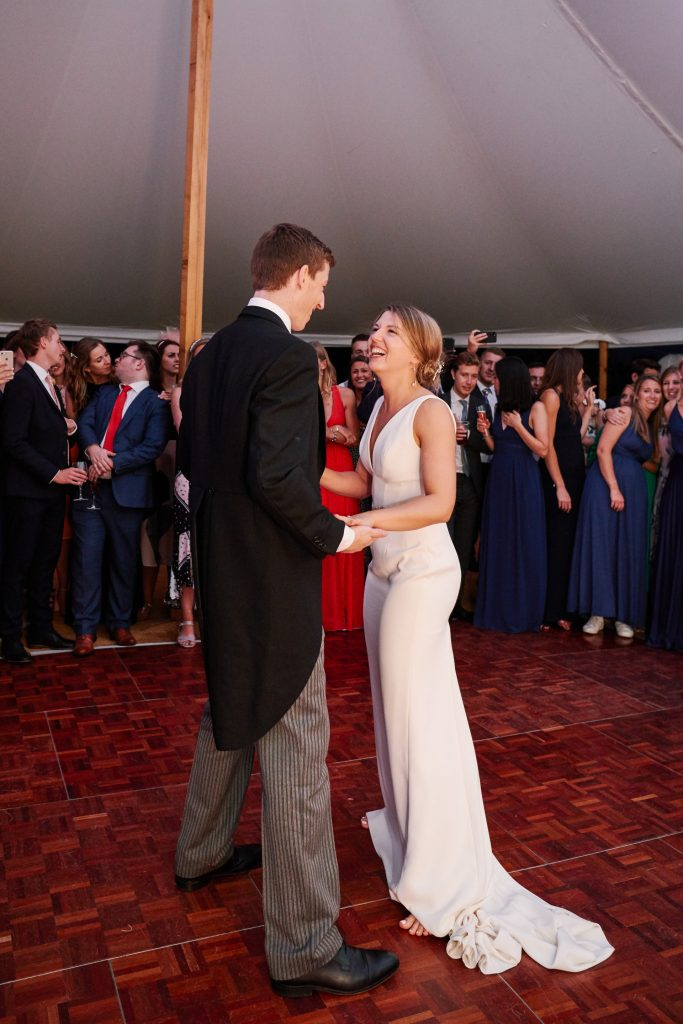 Wedding couple dancing during evening marquee reception at Pamber Place