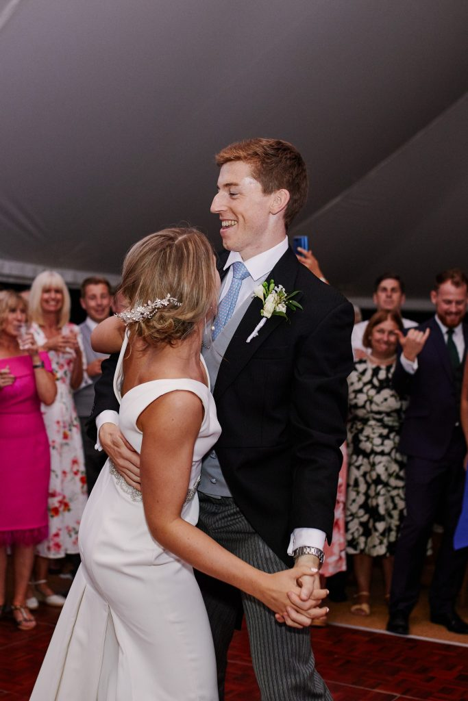 Bride & groom dancing during evening marquee reception at Pamber Place