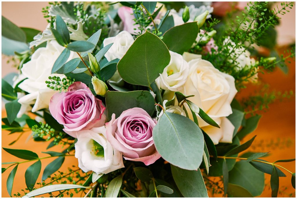 Beautiful wedding flower bouquet with pink and cream roses