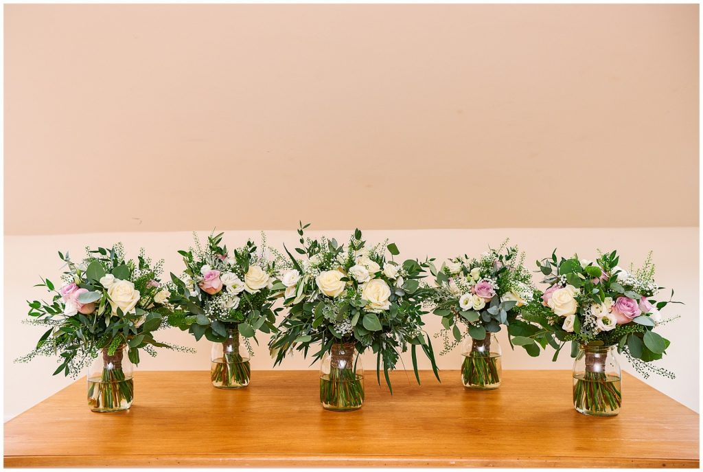 Beautiful wedding flower bouquets featuring pink and cream roses