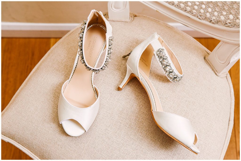 Beautiful wedding shoes with gems on cream chair
