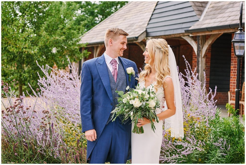 Bride and groom stood in the beautiful outdoor garden at Micklefield Hall
