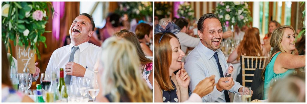 Happy wedding guests sat laughing during reception dinner at Micklefield Hall