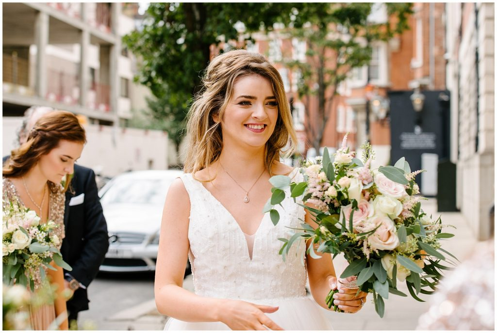 Bride smiling during summer wedding in Mayfair