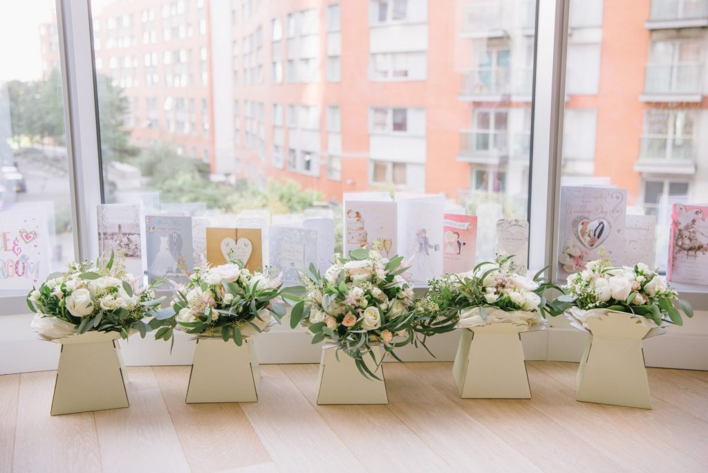 flower bouquets lined up in front of window