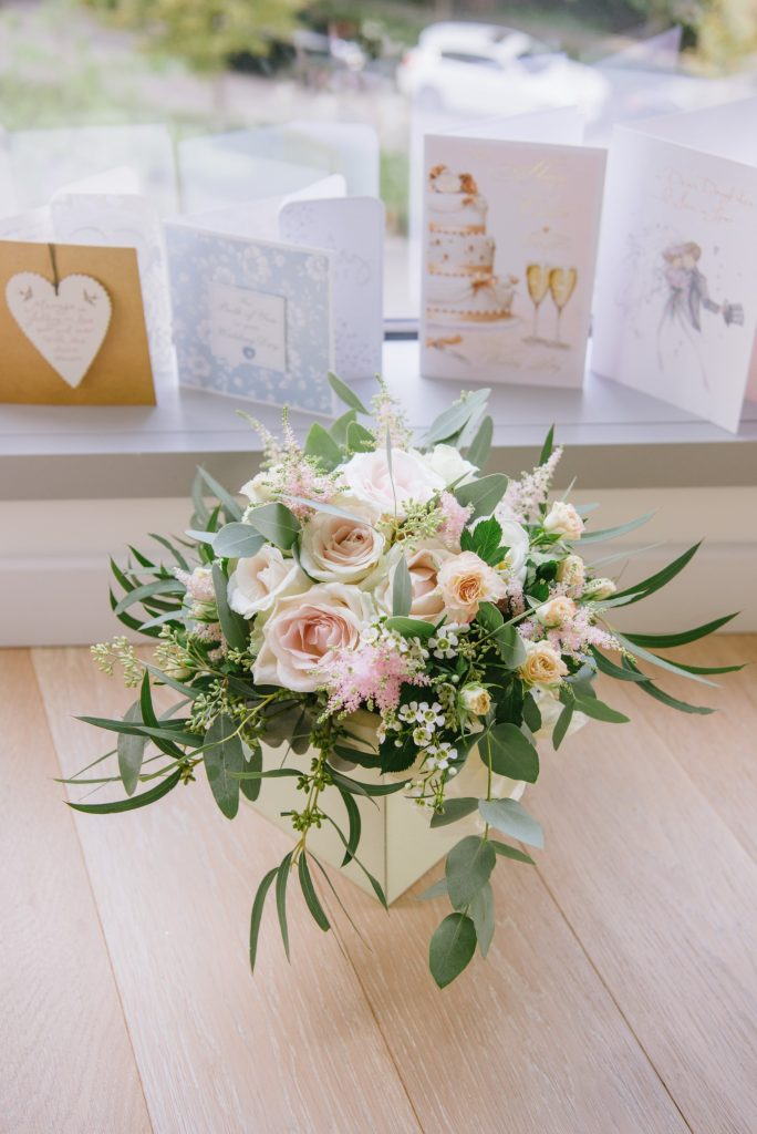 wedding flower bouquet in front of wedding card