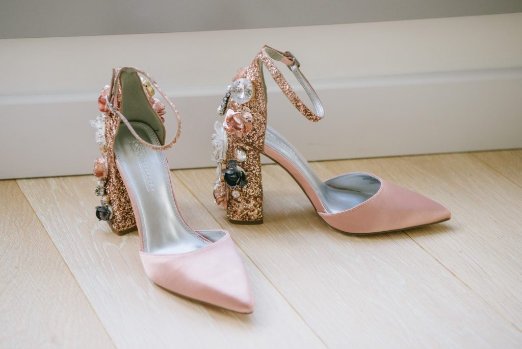 pink high heeled wedding shoes with glitter and shells on them