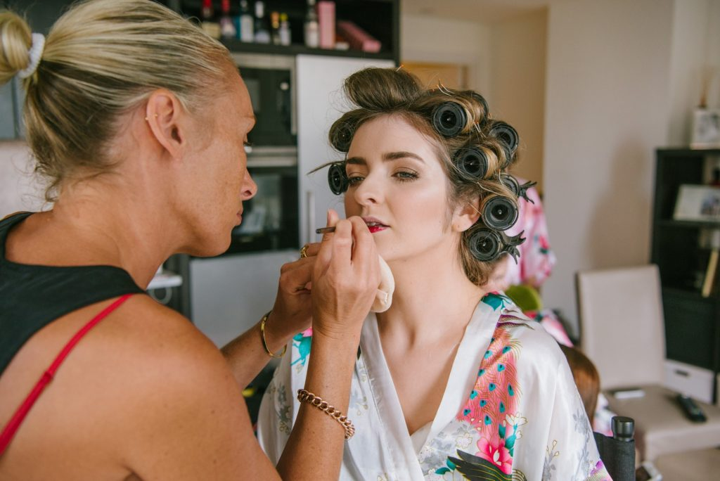 bride having her makeup applied at London home