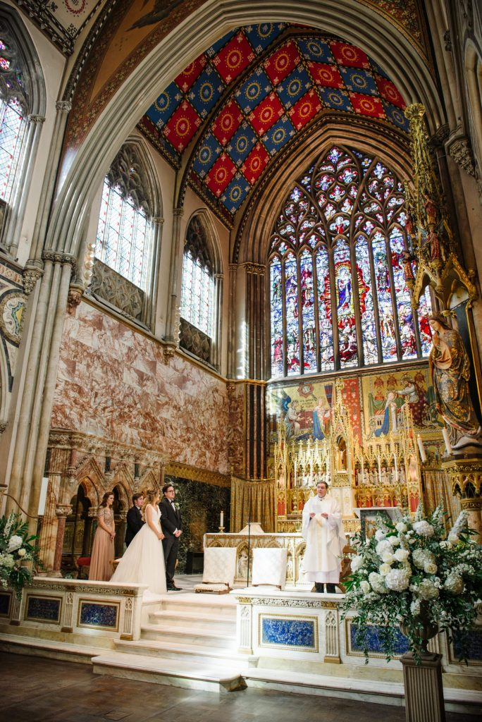 interior wide shot of wedding ceremony at Farm Street Church in Mayfair