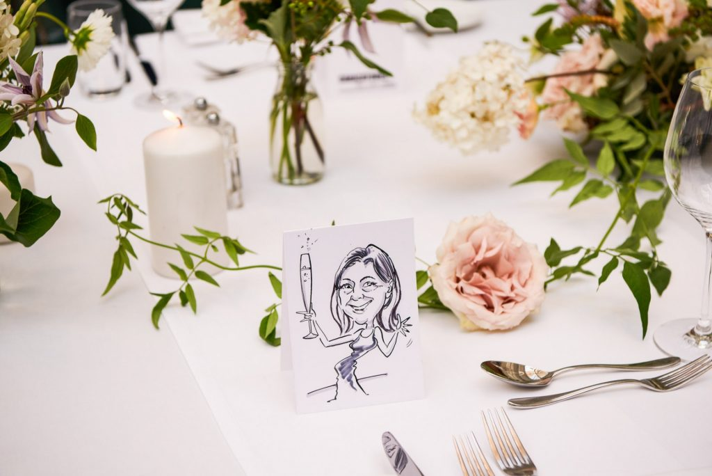 Caricature drawing of a wedding guest on the dinner table at Bluebird in Chelsea, London