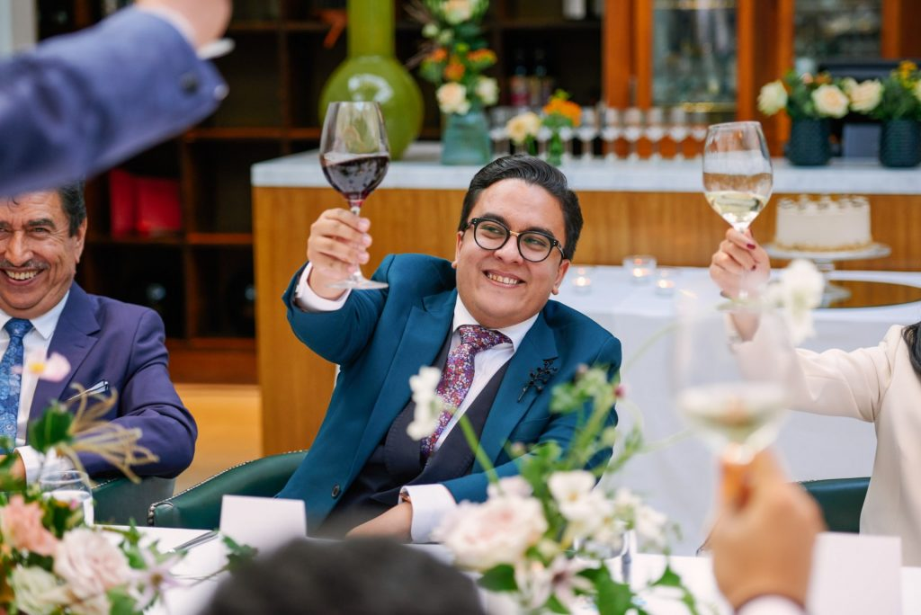 Happy groom toasting wedding speeches at The Bluebird in Chelsea