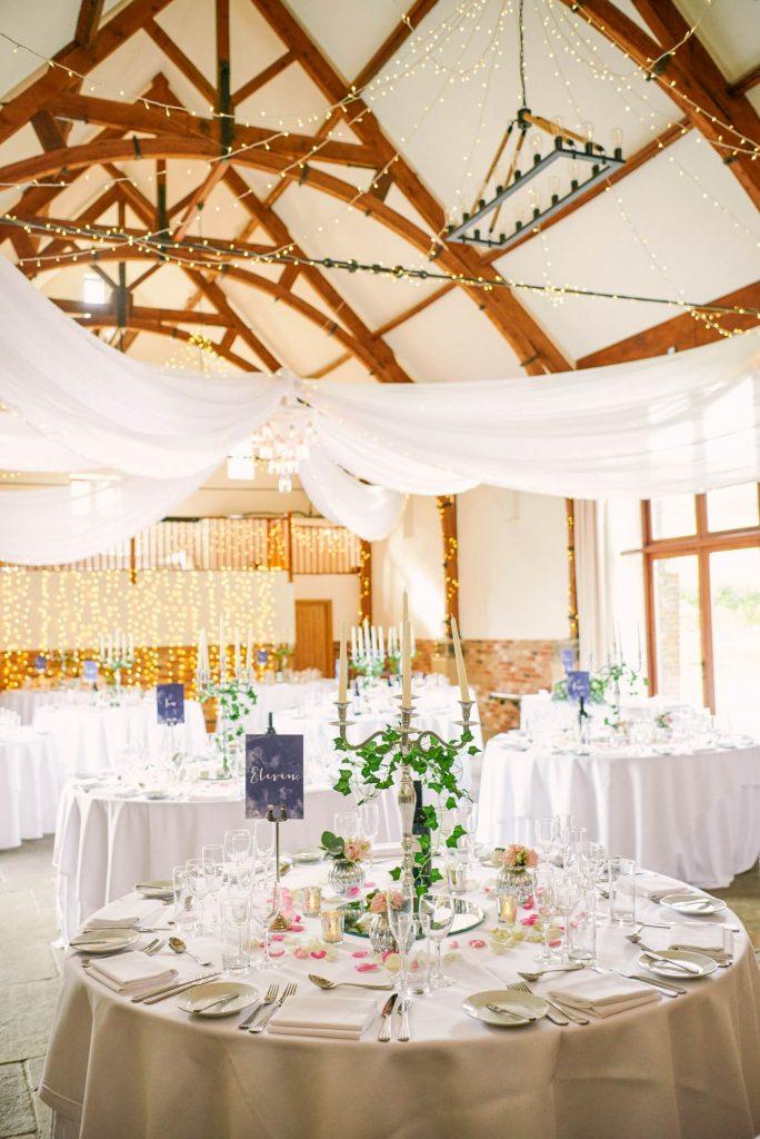 round wedding tables set up at Long Furlong Barn during winter wedding
