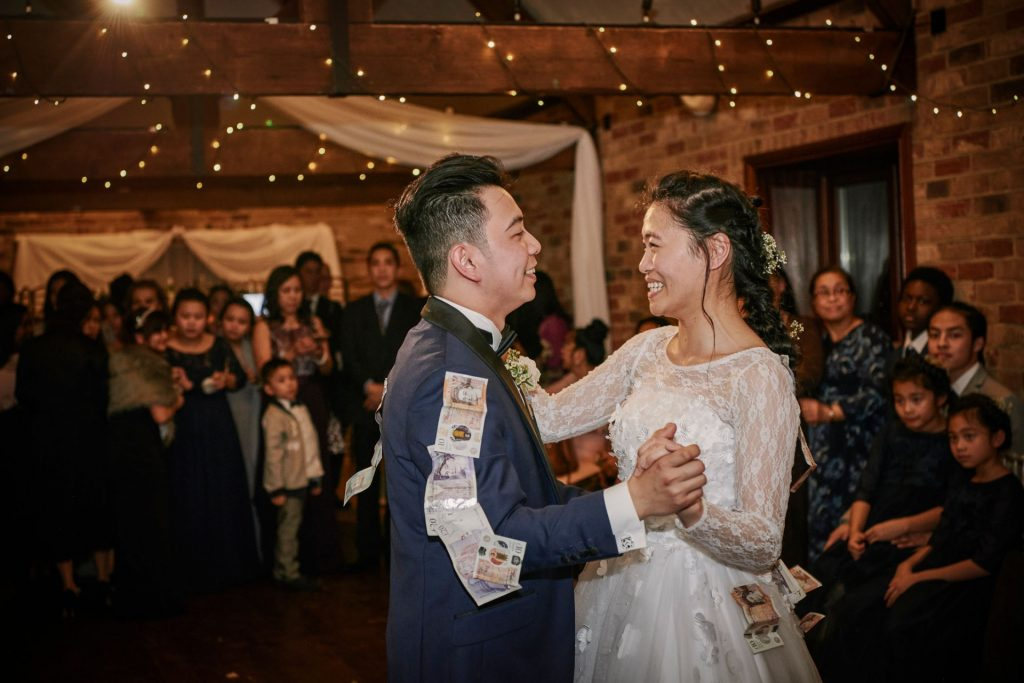 Bride and groom laughing during filipino money dance at Long Furlong Barn