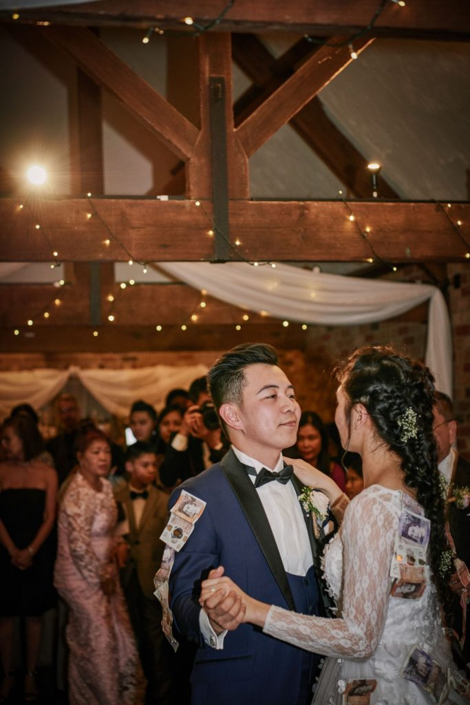 Bride and groom during filipino money dance at Long Furlong Barn