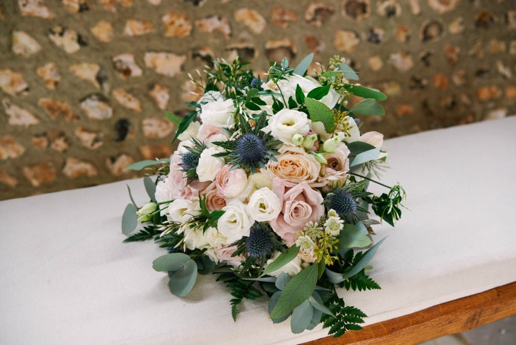 Brides wedding flower bouquet made of different colour roses.