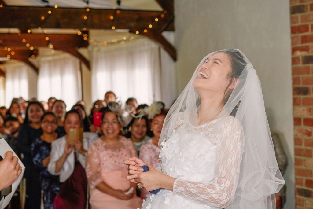 Bride laughing during rustic winter wedding ceremony
