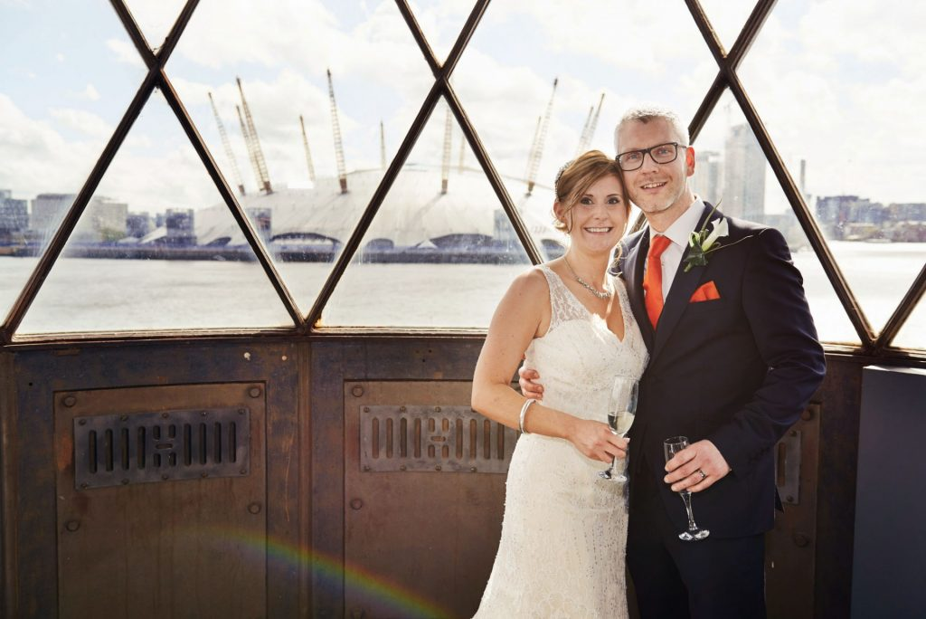 Wedding couple stood in the lighthouse at Trinity Buoy Wharf Chainstore Wedding Venue