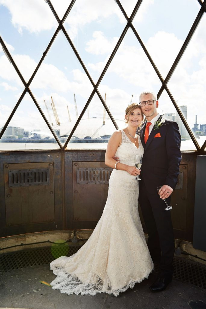 Wedding couple stood in the lighthouse at Trinity Bouy Wharf Chainstore Wedding Venue