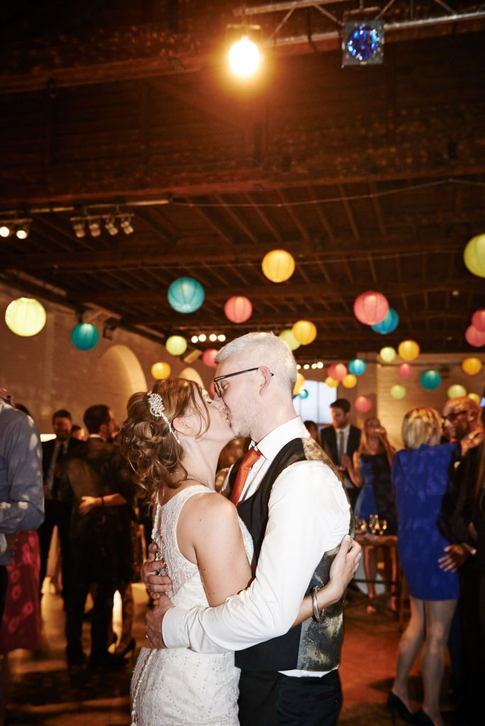 Wedding couple kissing during reception at Trinty Bouy Wharf Warehouse Wedding Venue