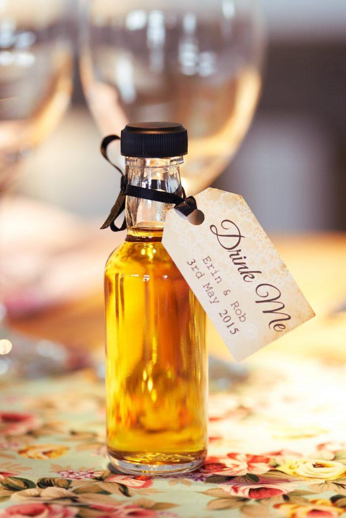mini drink me alcohol wedding favour bottles at DIY wedding