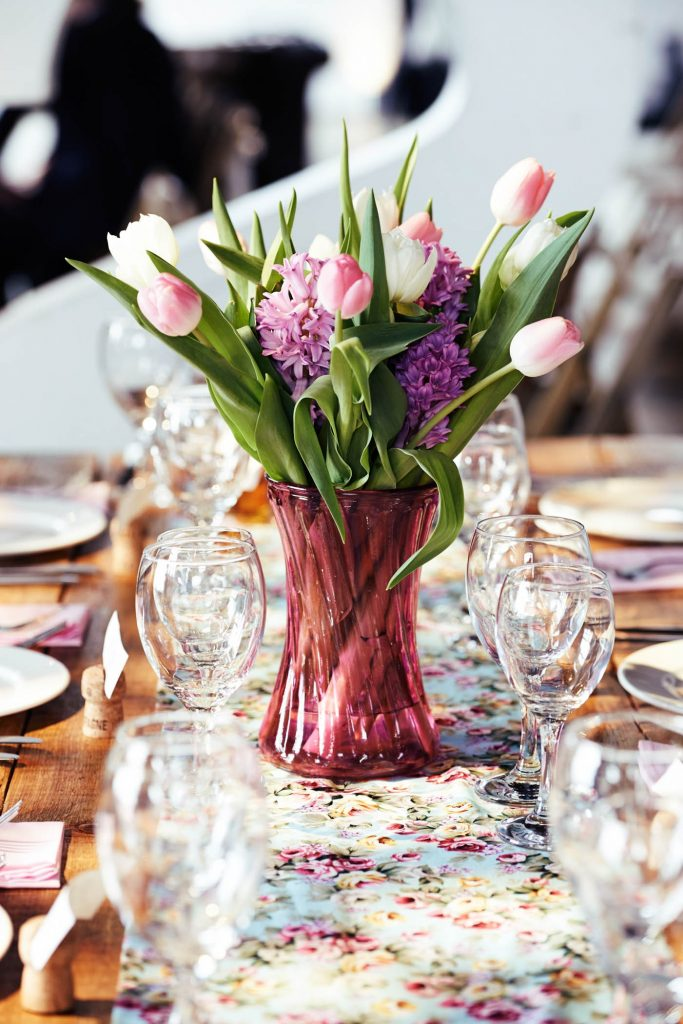 Flowers on DIY table at Trinity Bouy Wharf warehouse wedding